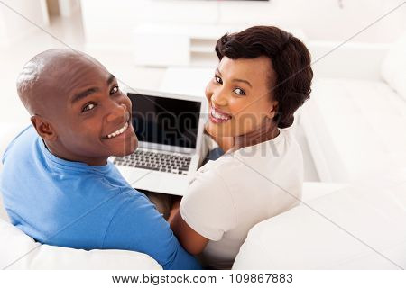 happy young african couple with laptop computer