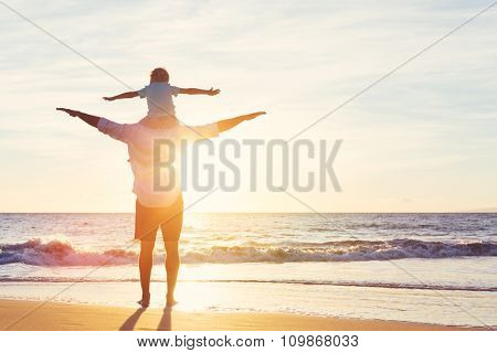 Happy Father and Son Having Fun Playing on the Beach at Sunset. Fatherhood Family Concept