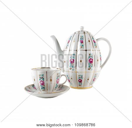 Porcelain teapot, teacup and saucer with floral roses ornament in retro style isolated on white