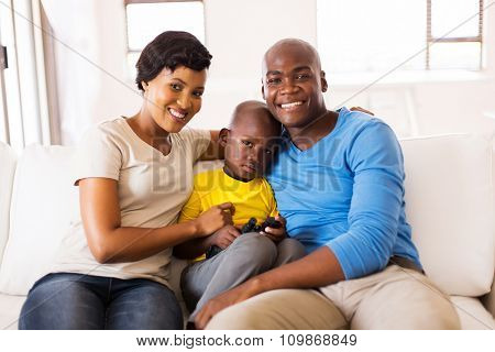 happy african american family sitting on the couch at home
