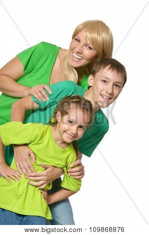 Happy family of four standing
