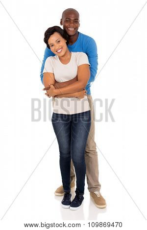 loving african man hugging his girlfriend isolated on white