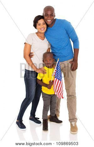 happy young family with american flag standing on white background