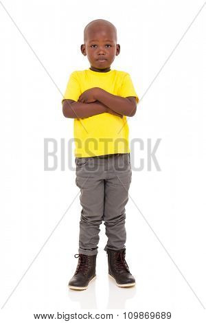 adorable young african boy with arms crossed on white background