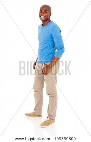 side view of african american man posing on white background