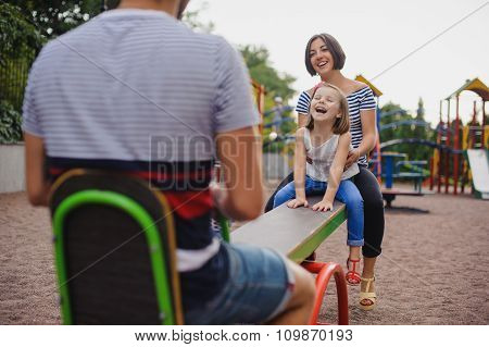 Family Having Fun On A Swing