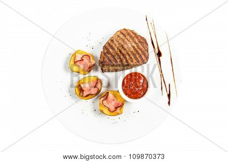 Juicy, And Beautiful Steak With A Side Dish Of Potatoes And Sauce