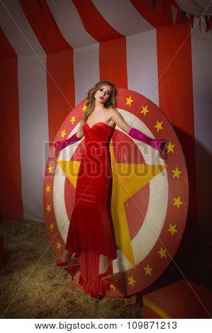 Circus Actress Stands On Circular Disc With Star