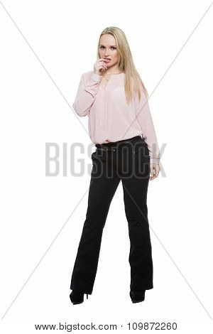 girl in pants and blous.  Isolated on white background. body language.  finger in his mouth. spaced