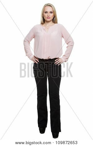 girl in pants and blous.  Isolated on white background. body language. legs wide apart, hands on hip