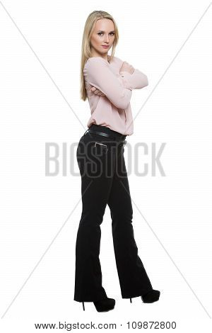 girl in pants and blous.  Isolated on white background. body language. legs wide apart, arms crossed
