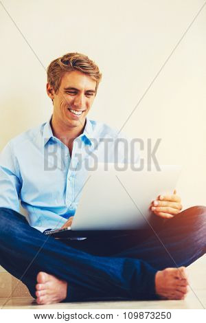 Young Man Using Laptop Working from Home