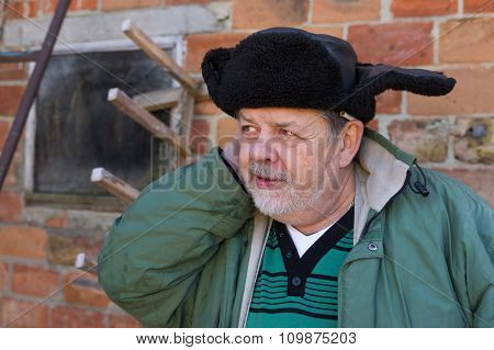 Outdoor portrait of a bearded Ukrainian peasant
