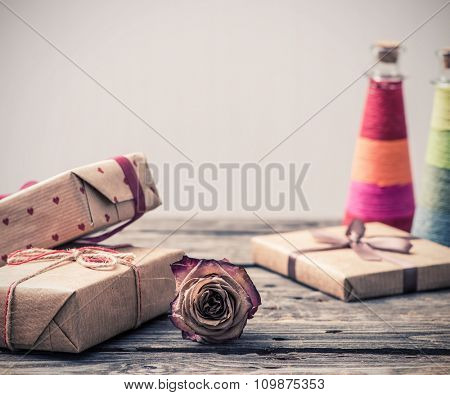 Dried rose flower and gift boxes on a table