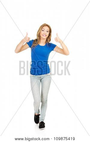 Young beautiful happy woman with thumbs up.