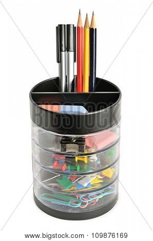 Office supplies in plastic cup isolated on white