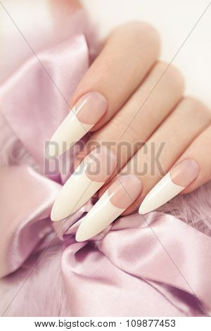 Long French manicure .