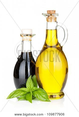 Olive oil and vinegar bottles with basil. Isolated on white background