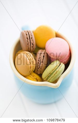 sweet french macarons in blue cup