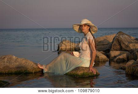 Beautiful girl on the sea.