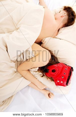 Woman sleeping in protective helmet with her husband.