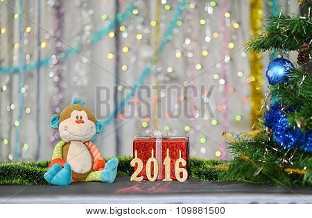 Christmas card 2016. Year of Monkey. Toy monkey, red gift