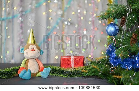Christmas card . Year of Monkey. Toy monkey and red gift