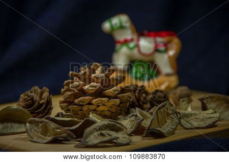 Christmas Pine Cones On A Wooden Board.