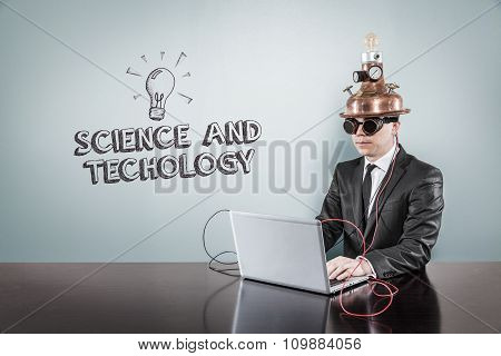Science and technology concept with vintage businessman and laptop