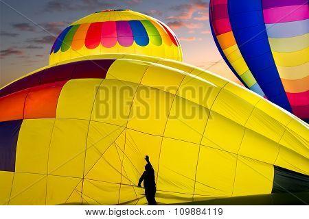 Worker Preparing Hot Air Balloons For Flight