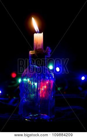 Decorative Transparent Candle Holder With Lighted Candle Inside.