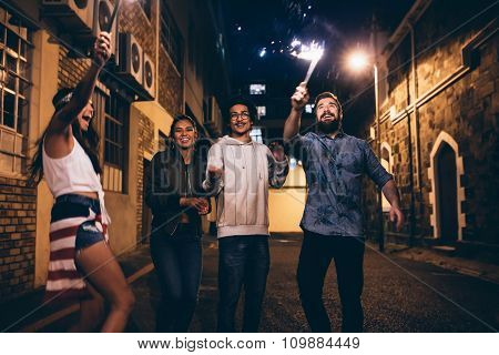Young People Playing With Sparklers At Night
