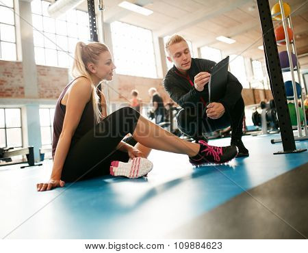 Trainer Helping Woman On Her Exercises Routines
