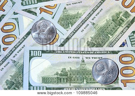 Commemorative Coins Soviet Rubles On Background Of Dollars Bills