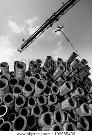 Crane and stack of pipes