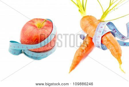 Red Carrots And Apple Wrapped In Measuring Tape