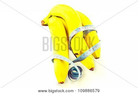 Yellow Banana Wrapped In Measuring Tape