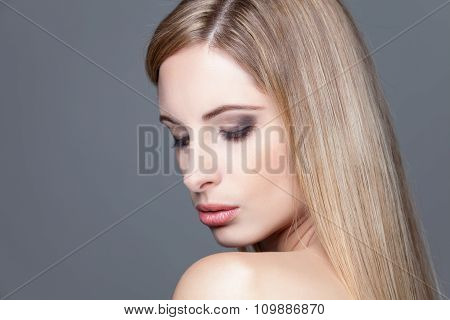 Young Blonde Beauty With Straight Hair