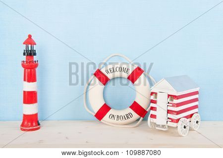 Beach with red lighthouse and welcome on board