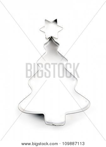 Christmas tree-like metal cookie cutter on white background