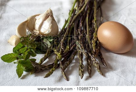 Ingredients on white background for a frittata