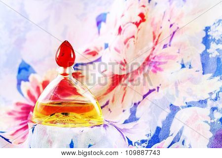 Perfume On Silk Background