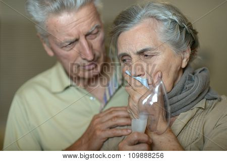 woman with flu inhalation