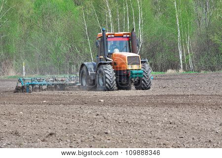 Tractor Cultivating Soil