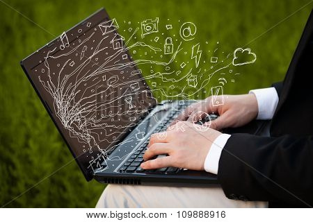 Man pressing notebook laptop computer with doodle icon media cloud symbols