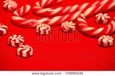 Red And White Caramel Candy On The Red Burlap