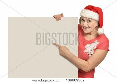 Senior woman  holding white blank
