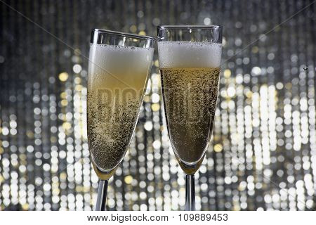 Champagne glasses on the shiny background
