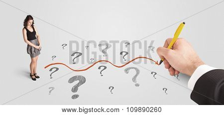 Business woman looking at question marks and solution path concept drawn by hand