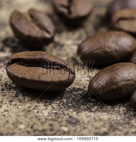 coffee beans on grunge surface closeup
